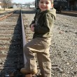 Foto de Stock  : Boy on Train Track