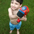 Boy Playing with Water Gun — Stockfoto #12822147