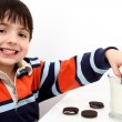 Adorable Boy Dunking Cookies in Milk — Stock Photo