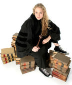 Young Blonde Judge Sitting on 70 Year Old Law Books — Stock Photo