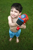 Boy Playing with Water Gun — Stok fotoğraf