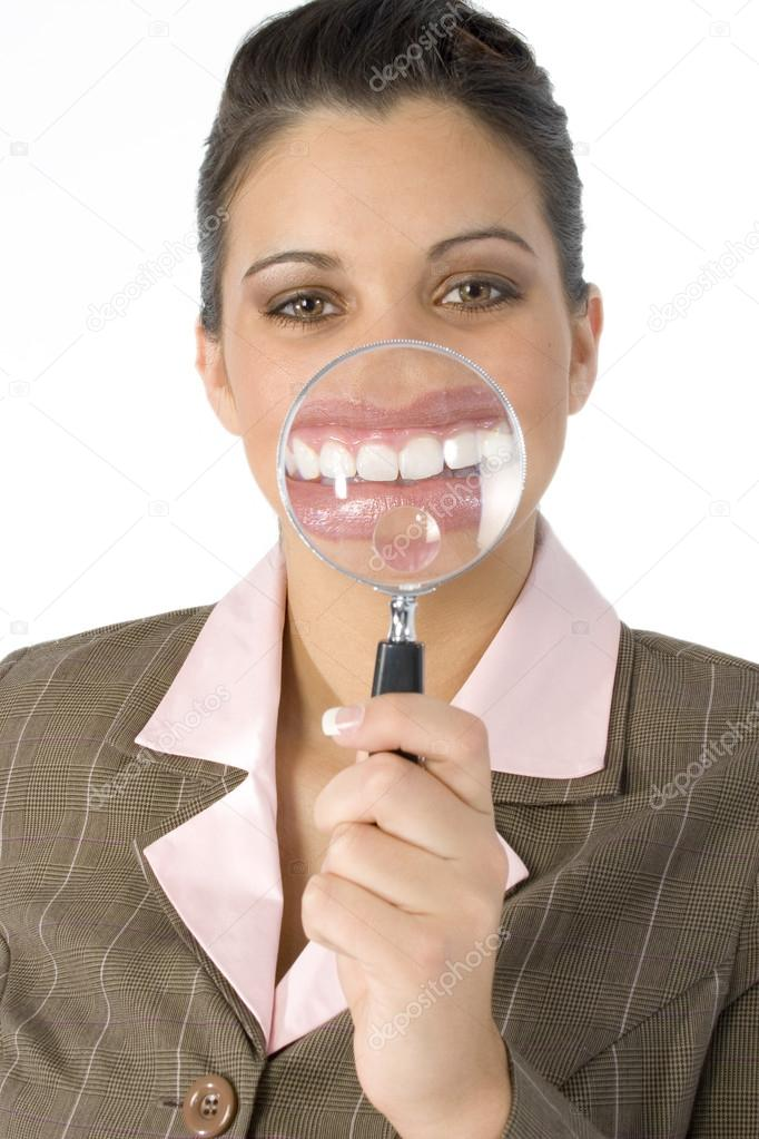 Beautiful Hispanic business woman with magnifying glass in front of mouth.  Created in camera... not photoshop.  Shot in studio over white. — Stock Photo #12821504