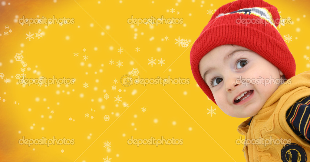 Toddler boy against a magical snow storm with space for copy — Photo #12822246