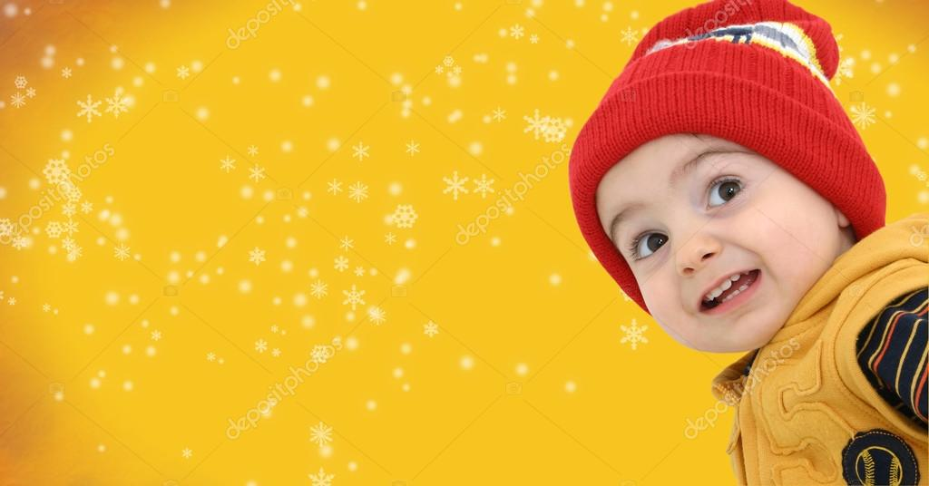 Toddler boy against a magical snow storm with space for copy — Foto de Stock   #12822246
