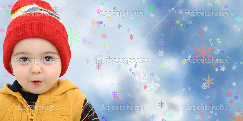 Toddler boy against a magical snow storm with space for copy — Stock Photo #12822259