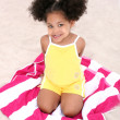Beautiful Young Girl Sitting On Beach Towel In The Sand — Stock Photo