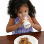 Little Girl Milk Cookies — Stock Photo