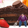 Woman on Giant Plate of Chocolate Cake - Foto Stock