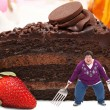 Woman on Giant Plate of Chocolate Cake — Stock Photo