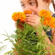 Girl Smelling Marigold — Stock Photo