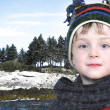 Happy Boy in Winter Clothes at Lake Park in Snow — Stock Photo #12830577