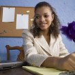 Attractive African American Teen Girl at Desk - Stock Photo