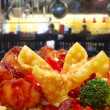 Rangoon and General Tso Chicken in Restaurant - Stock Photo