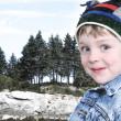 Happy Boy in Winter Clothes at Lake Park in Snow — Stock Photo