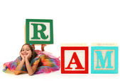 Girl with Alphabet Block RAM — Stock Photo