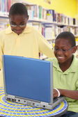 Two Handsom Black Students at Laptop in School Library — Stock Photo