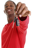 Casual Young Man Holding Out Car Key — Stock Photo