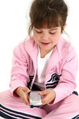Beautiful Five Year Old Girl In Pink Workout Clothes With Cellph — Stock Photo
