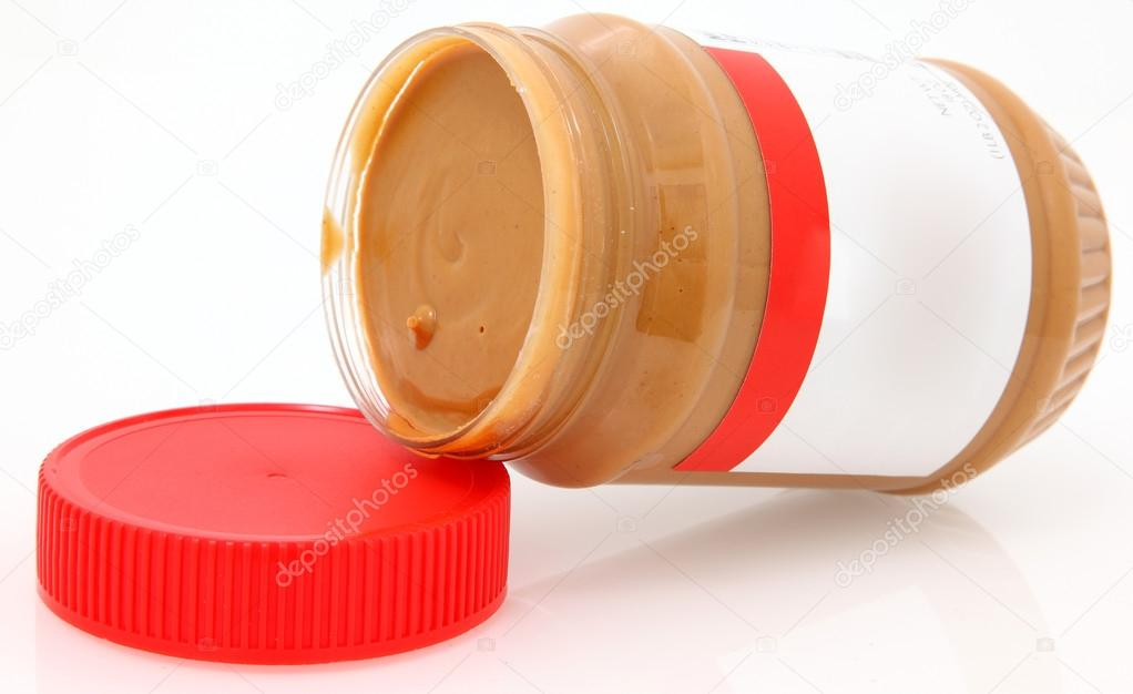 Open jar of creamy peanut butter with blank label to add text. — Stock Photo #12948847