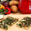 Spinach and Portobello Mushroom Pizza - Stock Photo