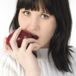 Beautiful Young Woman Eating Apple — Stock Photo