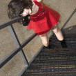 Beautiful Young Woman In Red Vinyl Dress On Fire Escape — Stock Photo