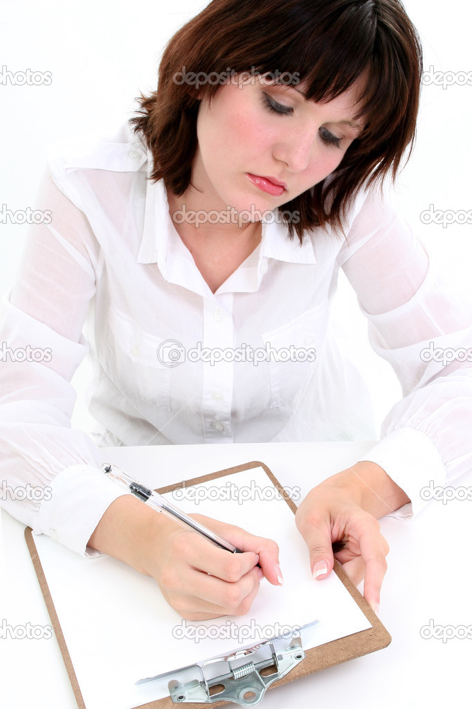 Beautiful young woman writing with pen on clipboard. — Stock Photo #13120404