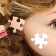Foto Stock: Puzzle Girl Face