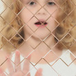 Foto Stock: Autistic Child Blurred Behind Pane Of Glass