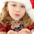 Child Blowing Snowflakes - Stock Photo