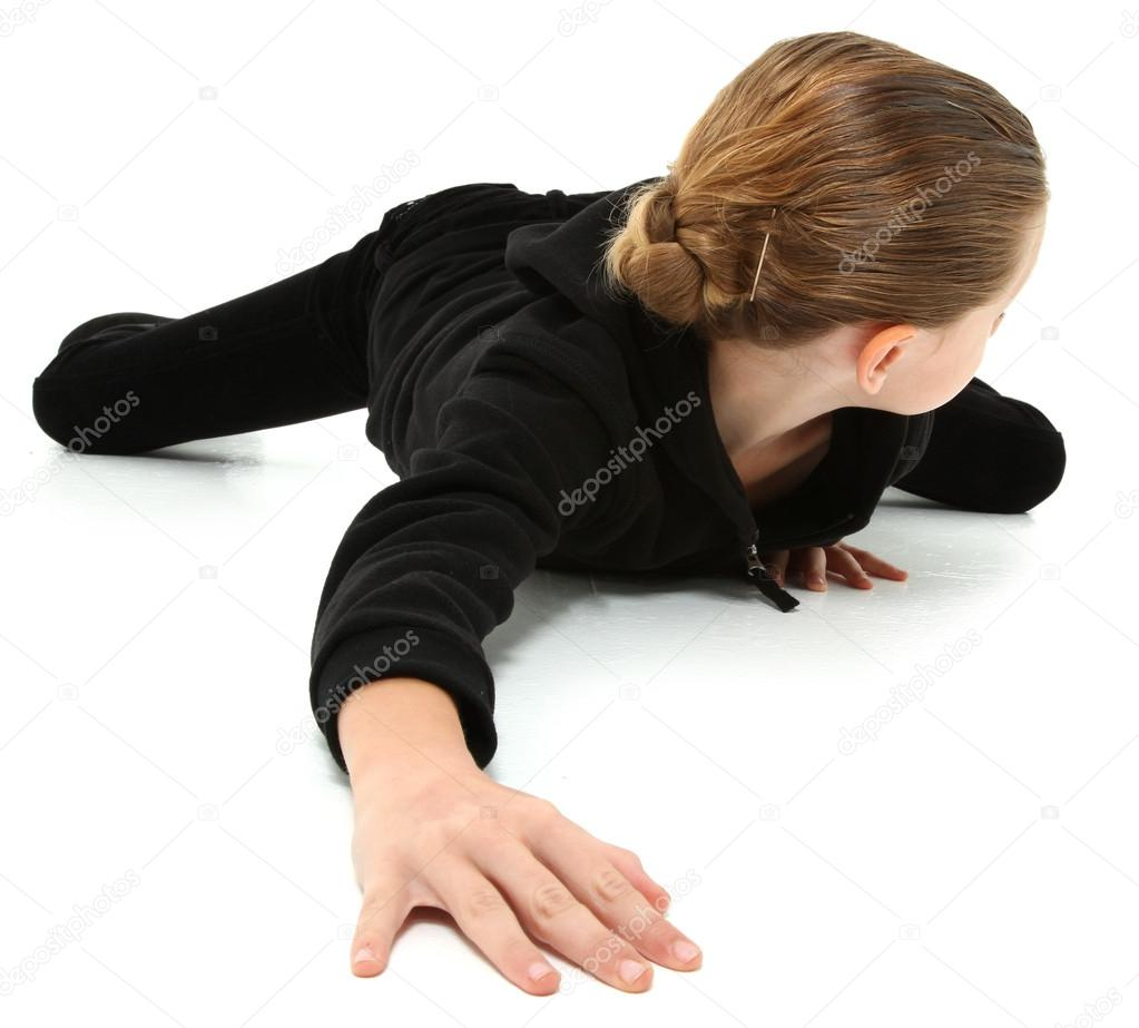 Adorable 7 year old girl in black suit crawling and looking behind on white floor. — Stock Photo #13181337