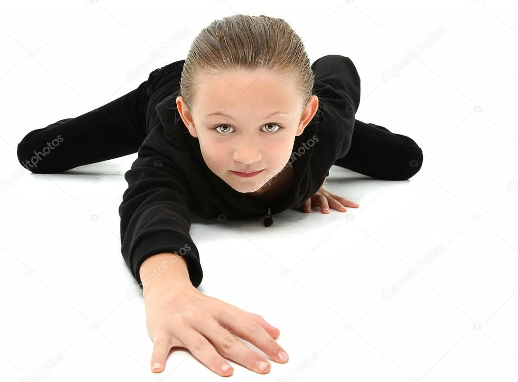Crawling 7 year old Girl in Black - Stock Image