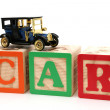 Stock Photo: Antique Black Car on ABC Blocks