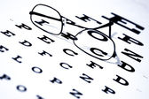 Eye Chart and Glasses — Stock Photo