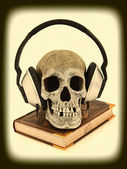Audiobook Concept Human Skull with Headset on Book, Scary, Haunt — Stock Photo