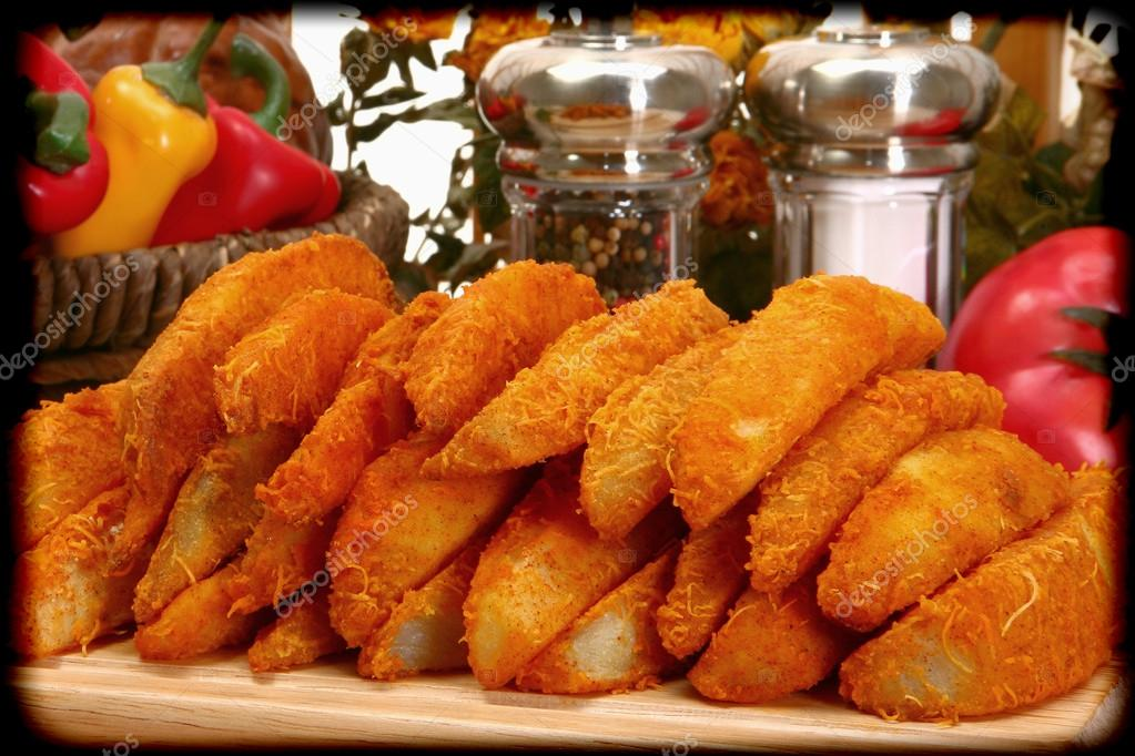 Baked battered spicy seasoned potato wedges in kitchen for Kitchen plus 2000 vs 3000
