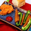 Fried Chicken Tender with Potato Wedges and Green Bell Pepper - Stockfoto
