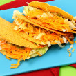 Three American Style Beef Tacos on Cutting Board - Stockfoto