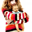 Foto Stock: Lonely Abandoned Child Hugging Doll