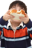 Boy with peanutbutter sandwich — Stock Photo