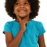 śliczny czarny dziewczynka dziecko myśli gest i uśmiechając się na Zielone Świątki — Zdjęcie stockowe