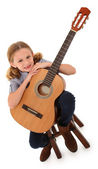 Beautiful ten year old with acoustic guitar over white with clip — Stock Photo