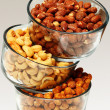 Stock Photo: Three glass bowls filled with cashews, salted roasted almonds an