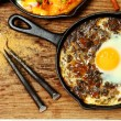 Stock Photo: Spinach Dal and Egg Skillet Breakfast