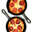 Two Single Serve Skillet Peperonni Pizzas Over White — Stock Photo #40541251
