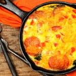 Постер, плакат: Skillet Peperoni and Spinach Egg Scramble