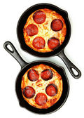 Two Single Serve Skillet Peperonni Pizzas Over White — Stock Photo