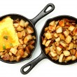 Stock Photo: Denver Omelette and Ranch Potatoes in Cast Iron Skillet Isolated