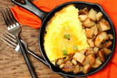 Denver Omelette and Ranch Potatoes in Cast Iron Skillet on Table — Stock Photo
