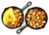 Denver Omelette and Ranch Potatoes in Cast Iron Skillet Isolated — Stock Photo